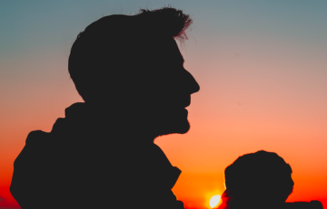 father-and-baby-sunset-silhouette