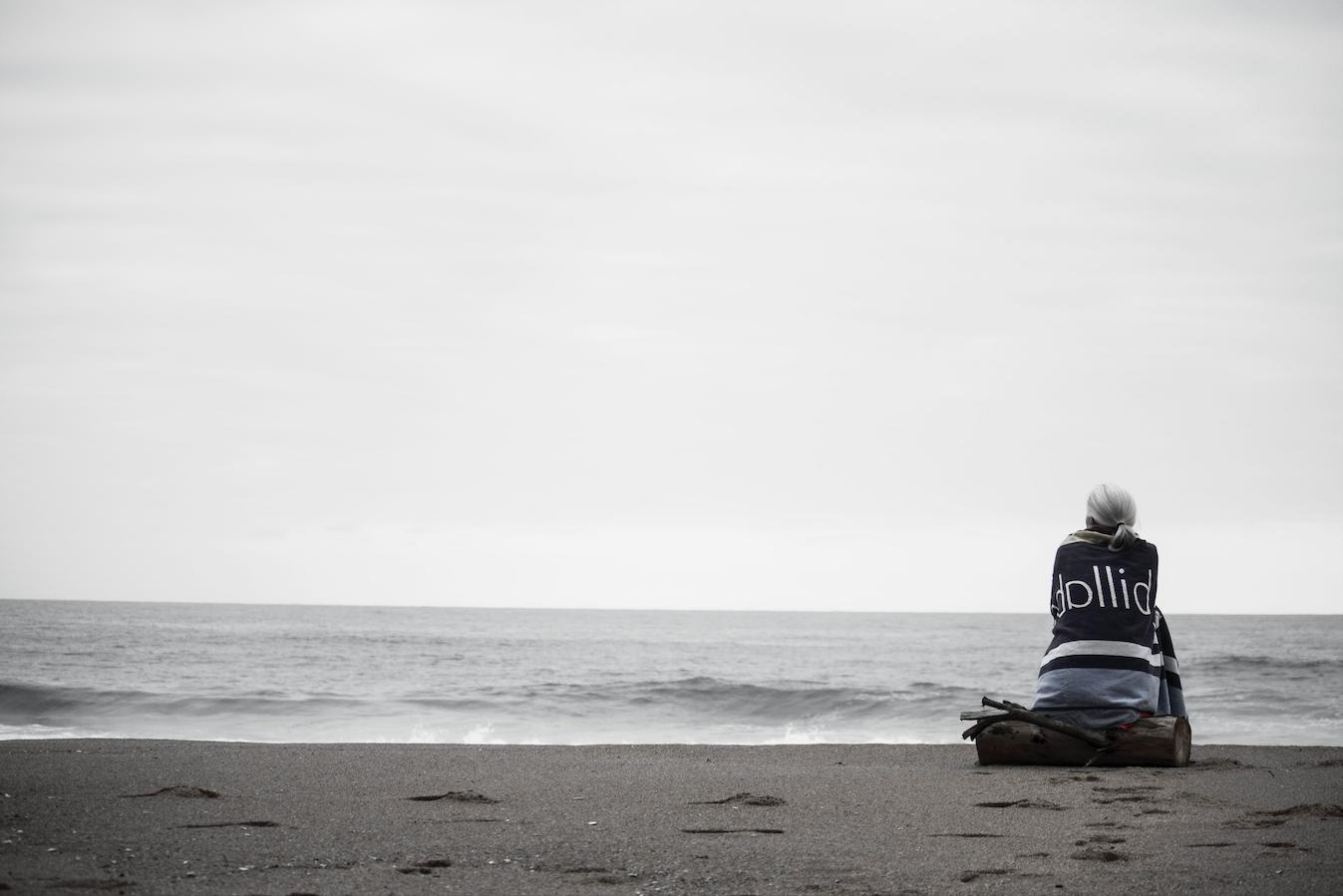 sad-woman-sitting-alone-on-beach